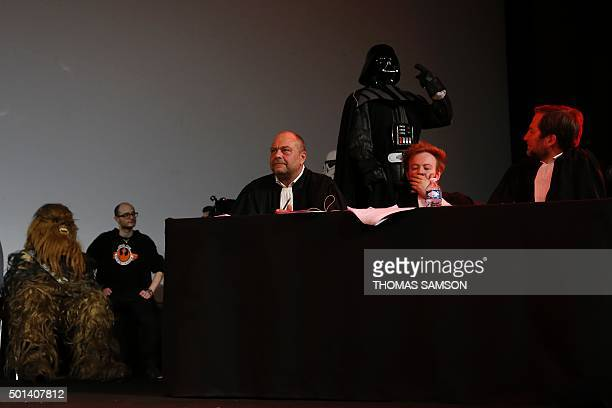 French lawyers Eric DupondMoretti Antoine Vey and Patrice Spinosi sit next to a person wearing a Darth Vader costume during the Darth Vader's trial...