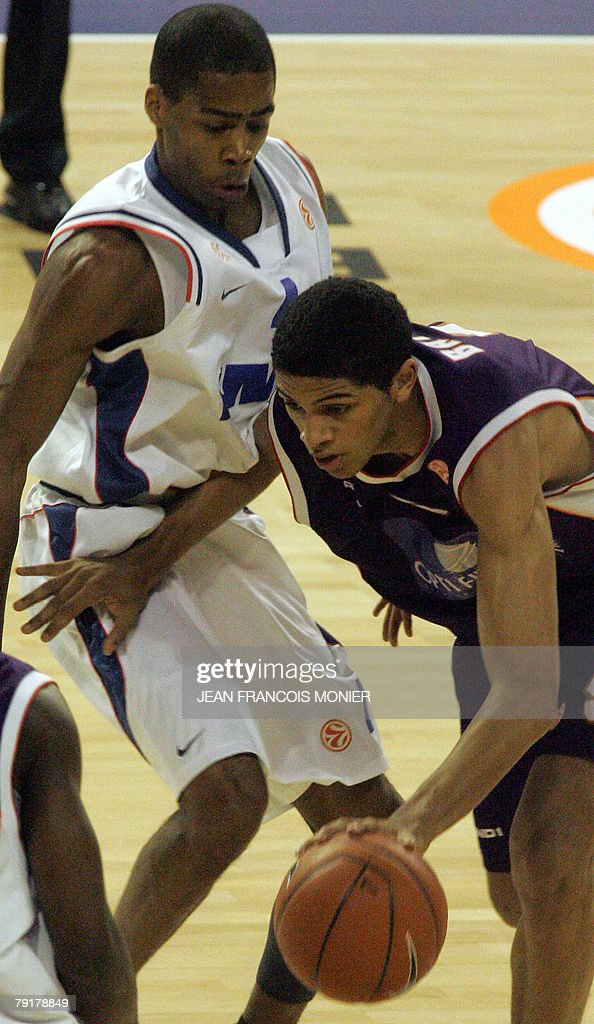 French Le Mans? forward Nicolas Batum (R) fights for the ball with Cibona Zagreb?s forward US Chris Warren (L) during their Euroleague Basketball match in Le Mans, 23 January 2008.