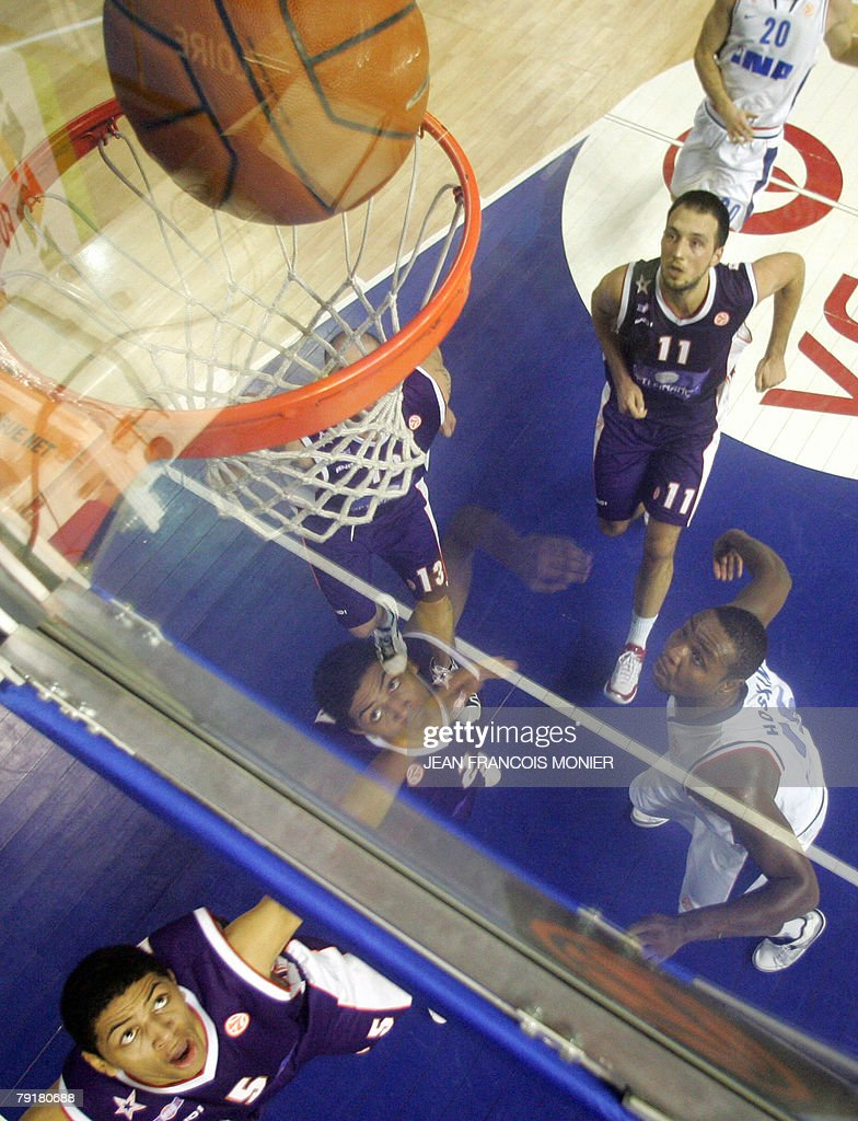 French Le Mans? forward Nicolas Batum (L) scores against Cibona Zagreb forward Sam Hoskin (R) of the US during their Euroleague basketball match in Le Mans, 23 January 2008.