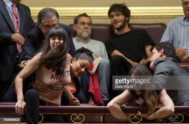 French leader of feminist movement Femen Pauline Hillier and Spanish leader of feminist movement Femen Lara Alcazar are apprehended during a prolife...