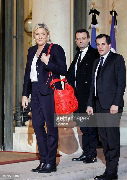 French leader of the French Farright party Front National Marine Le Pen flanked by FN vicepresident Florian Philippot and FN secretary general...