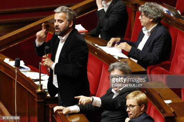 French leftist La France Insoumise members of Parliament Alexis Corbiere and JeanLuc Melenchon gestures while speaking during a debate prior to the...