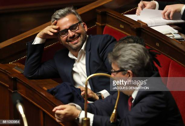 French leftist La France Insoumise party leader JeanLuc Melenchon and LFI's MP Alexis Corbiere attend a session of questions to the government at the...