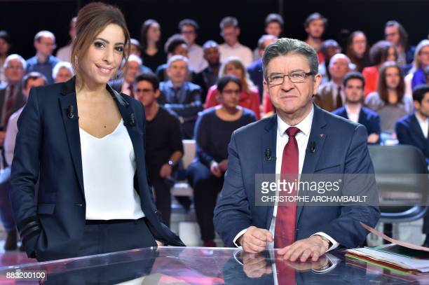 French leftist La France Insoumise party leader JeanLuc Melenchon and French journalist Lea Salame pose prior to take part in the political TV show...