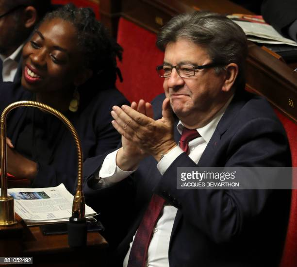 French leftist La France Insoumise party leader JeanLuc Melenchon flanked by LFI's MP Daniele Obono attend a session of questions to the government...