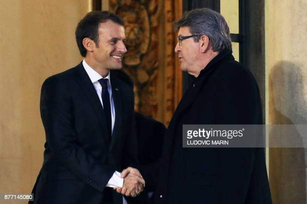 French leftist La France Insoumise party leader JeanLuc Melenchon shakes hands with French President Emmanuel Macron as he leaves after their meeting...