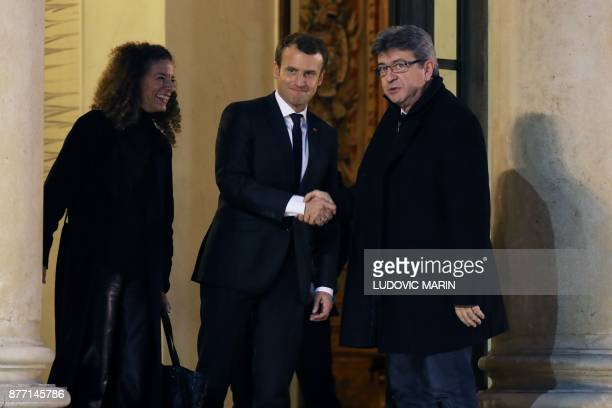 French leftist La France Insoumise party leader JeanLuc Melenchon shakes hands with French President Emmanuel Macron as LFI spokeswoman Charlotte...