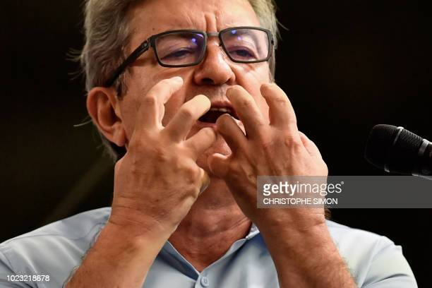 French leftist La France Insoumise party's leader and member of Parliament JeanLuc Melenchon gestures as he delivers a speech during the LFI summer...
