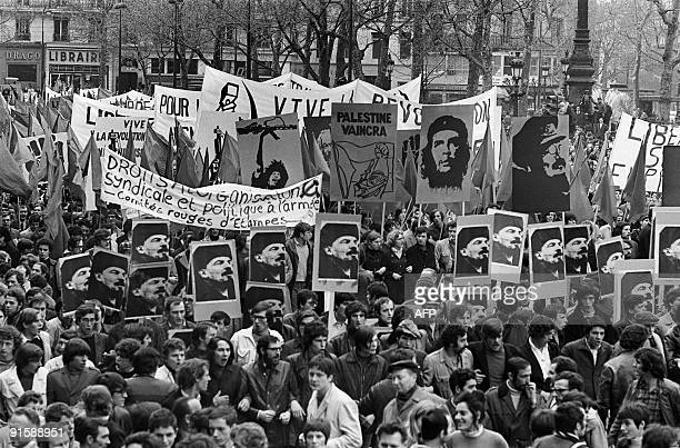 French leftist militants hold Che Guevara proViet Cong and proPalestinians posters while they demonstrate during May Day 1970 at Place de la...