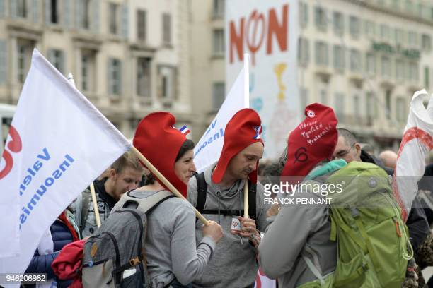 French leftist party La France Insoumise members take part in a march called Stop Macron on April 14 2018 in Marseille southern France to protest...