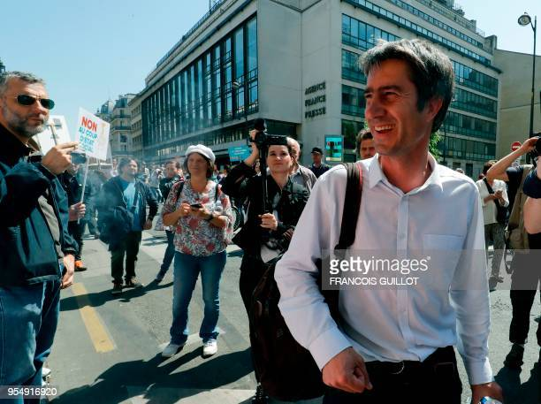 French leftist party 'La France Insoumise' MP Francois Ruffin walks past International News Agency Agence France Presse headquarters during 'The...