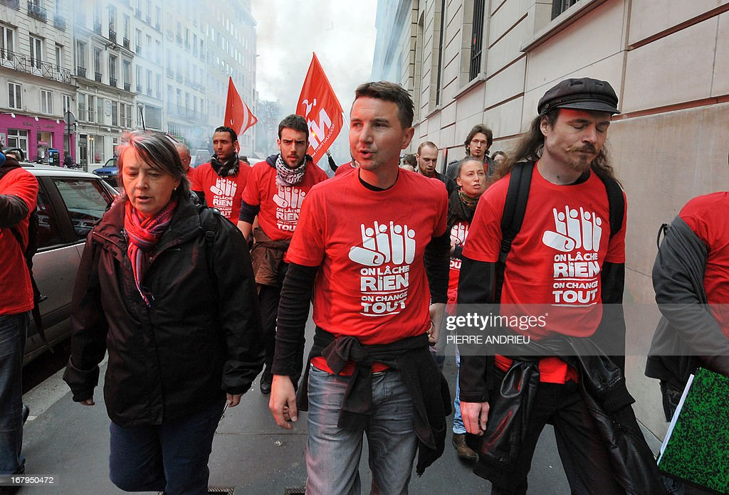 French leftist party NPA leader Olivier Besancenot (C) and some 20 other militants demonstrate near the Banque de France (Bank of France) headquarters on May 3, 2013 in Paris, to protest against the government as 'official sponsor of tax havens.'