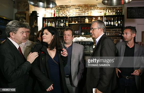 French leftwing party 'Parti de Gauche' copresident JeanLuc Melenchon speaks with Left Party's candidate in the IledeFrance region for the European...