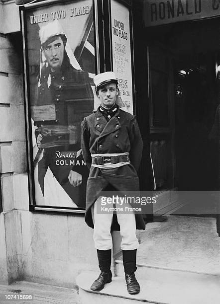 French Legionnaire In Front Of Poster Of Under Two Flags Film In London On 1938