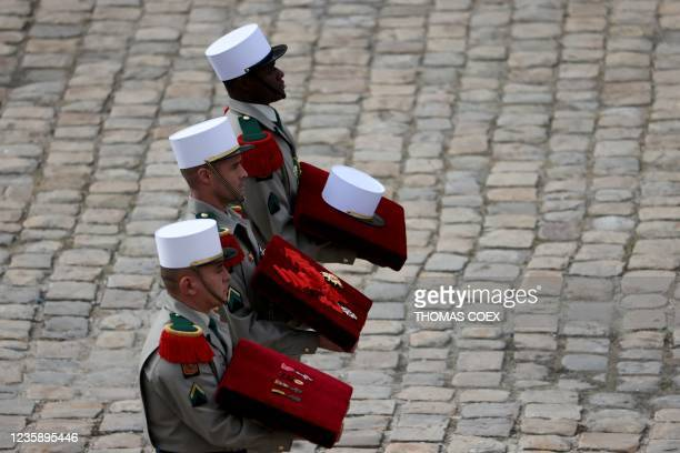 French Legionnaires carry medals behind the coffin of Hubert Germain during the national memorial service for him - the last surviving Liberation...