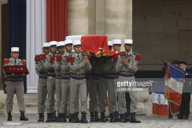 French legionnaires carry the coffin during a national memorial service for Hubert Germain - the last surviving Liberation companion - at The Hotel...