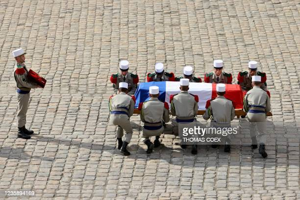 French legionnaires carry the coffin of Hubert Germain during a national memorial service for him - the last surviving Liberation companion - at The...