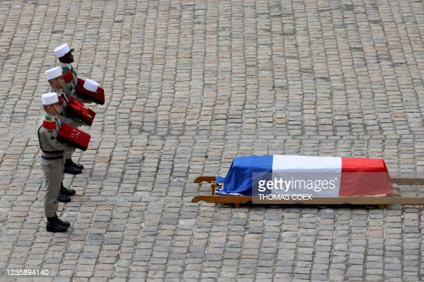 French legionnaires carry the medals of Hubert Germain, as they stand behind his coffin during a national memorial service for him - the last...
