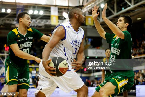 French Levallois Metropolitans' power forward Boris Diaw works around Limoges' shooting guard Axel Bouteille during the Pro A basketball match...