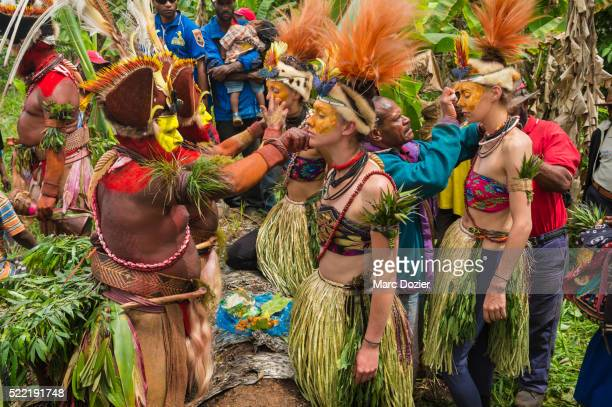 french lido's dancers dressed in traditional papuan clothes - tari stock pictures, royalty-free photos & images