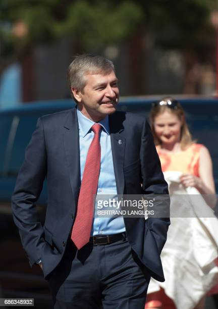 French Ligue 1 football club Monaco's Russian president Dmitriy Rybolovlev arrives with Monaco's players at the Prince's Palace on May 21, 2017 in...