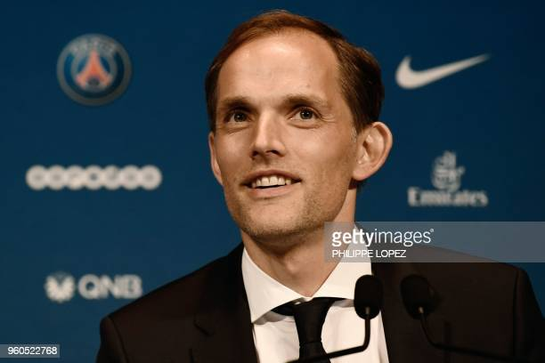 French Ligue 1 football club Paris SaintGermain's newly appointed coach German Thomas Tuchel smiles during a press conference after being officially...