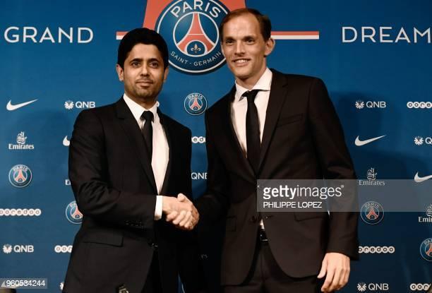 French Ligue 1 football club Paris SaintGermain's newly appointed coach German Thomas Tuchel shakes hand with club's president Nasser AlKhelaifi...