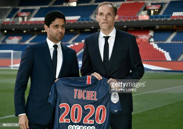 French Ligue 1 football club Paris SaintGermain's newly appointed coach German Thomas Tuchel poses with club's president Nasser AlKhelaifi after a...