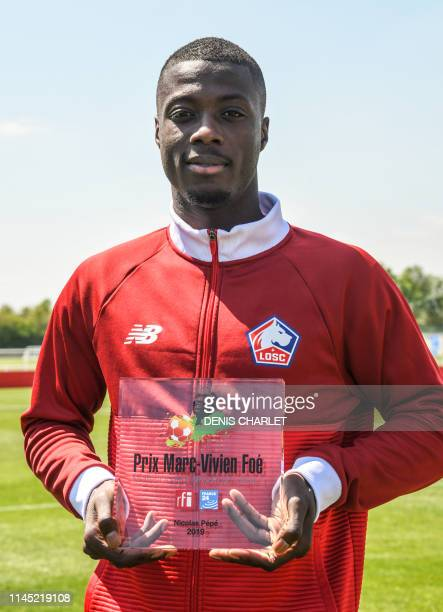 French Ligue 1 side Lille striker Nicolas Pepe holds the MarcVivien Foe Prize after being voted Best Player 2019 who represents an African national...