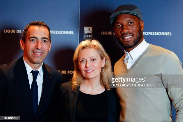 French Ligue de football professionnel's president Nathalie Boy de La Tour poses with French former football player Youri Djorkaeff and Ivory Coast...