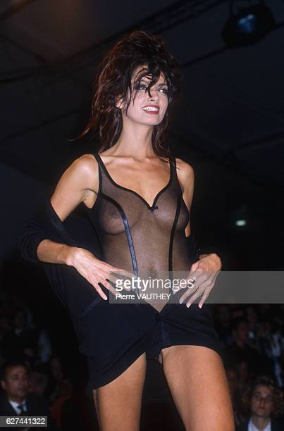 French lingerie designer Chantal Thomass shows her women's 1991 springsummer line in Paris The model is displaying a sheer bodysuit with a sweetheart...