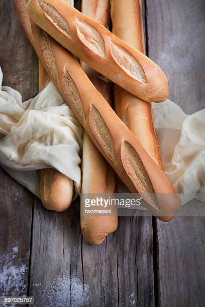 French loaf bread on wooden background.