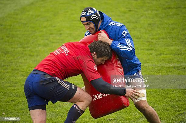 French lock Yoann Maestri and flanker Bernard Le Roux take part in a French national team training session on November 5, 2013 in Marcoussis, outside...