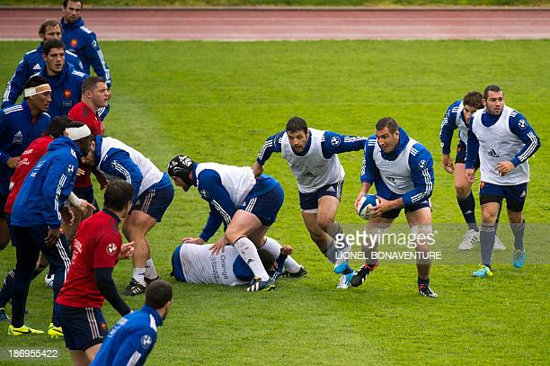French lock Yoann Maestri runs with the ball during a French national team training session on November 5, 2013 in Marcoussis, outside Paris, a few...