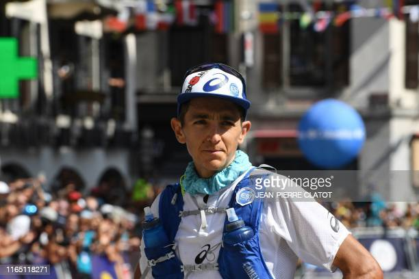 French long-distance runner Xavier Thevenard looks on after crossing the finish line to take the second place in the 170 km Mount Blanc Ultra Trail...