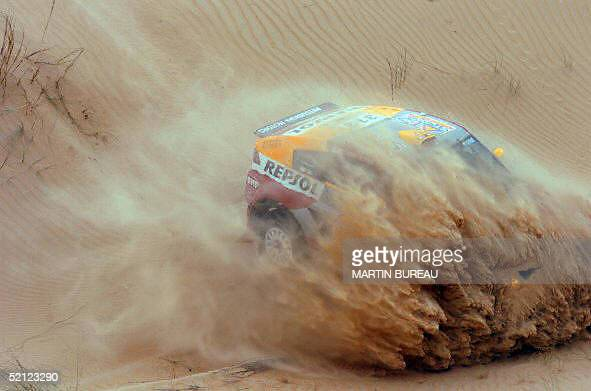French Luc Alphand drives his Mitsubishi Pajero Evo 10 January 2005 during the tenth stage of the 27th Dakar Rally around Atar AFP PHOTO/GETTY...