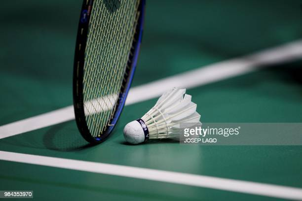 French Lucas Maurice Corvee reaches for the shuttlecock during the badminton Men's Singles Finals - Gold Medal Match at the XVIII Mediterranean Games...