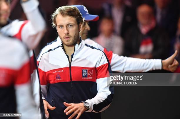 French Lucas Pouille looks on prior the single tennis match against Croatian player Marin Cilic as part of the Davis Cup final between France and...