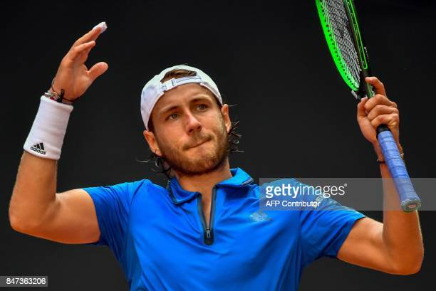 French Lucas Pouille reacts after losing a point against French Lucas Pouille during their singles rubber for the Davis Cup World Group semifinal...