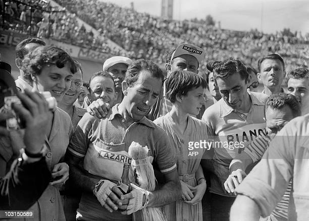 French Lucien Lazarides is congratulated after winning the 10th stage of the Tour de France 1955 MonacoMarseille on July 17 1955 in Marseille On the...