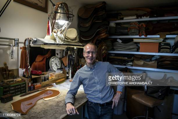 French luxury brand Hermes' saddler Laurent Goblet poses at his workshop at the Hermes saddlery in Paris on March 11 2019 Since 1880 Hermes has been...