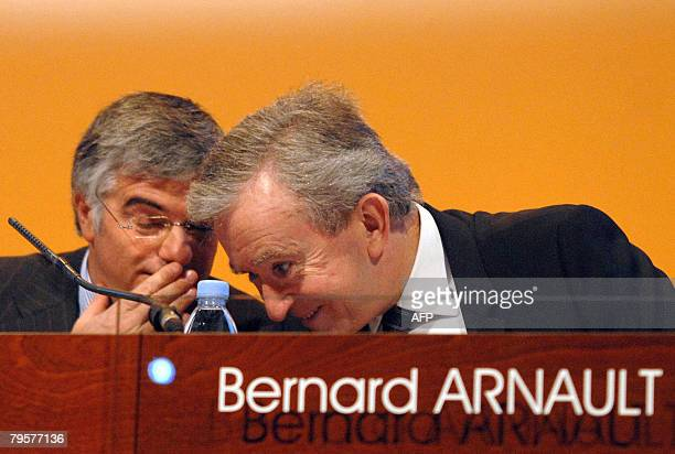 French luxury goods group LVMH CEO Bernard Arnault speaks with his company general director Antonio Belloni during a press conference to announce the...