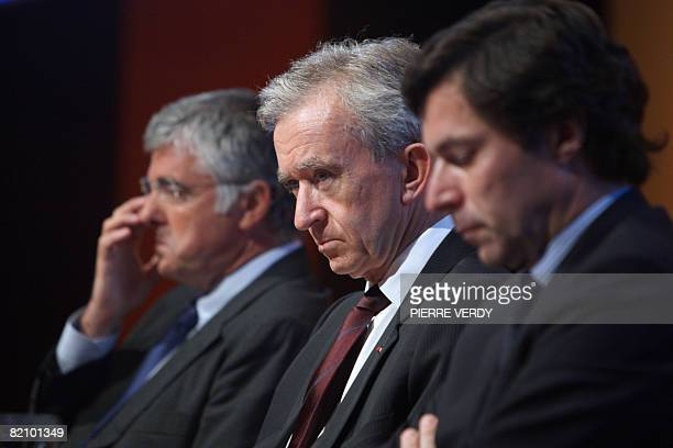 French luxury goods group LVMH chairman Bernard Arnault general director Antonio Belloni and finance director JeanJacques Guiony attend the group...