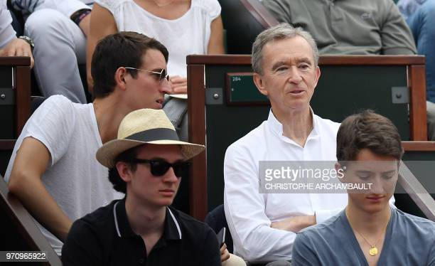 French Luxury group Chairman and CEO Bernard Arnault and his sons Alexandre Frederic and Jean look on during the men's singles final match between...