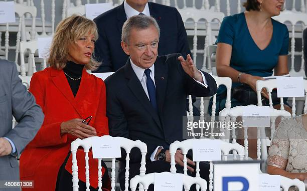 French luxury group LVMH Chairman and CEO Bernard Arnault and his wife Helene MercierArnault attend the preparation of the annual Bastille Day...
