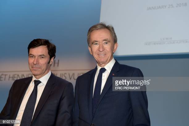 French luxury group LVMH Chairman and Chief Executive Officer Bernard Arnault and LVMH Group chief financial officer JeanJacques Guiony arrive to...