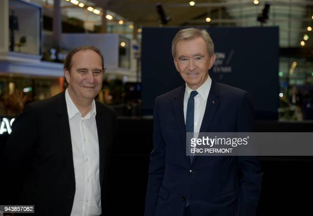 French luxury group LVMH Chairman and Chief Executive Officer Bernard Arnault poses with Iliad Group founder and vice-president Xavier Niel as they...