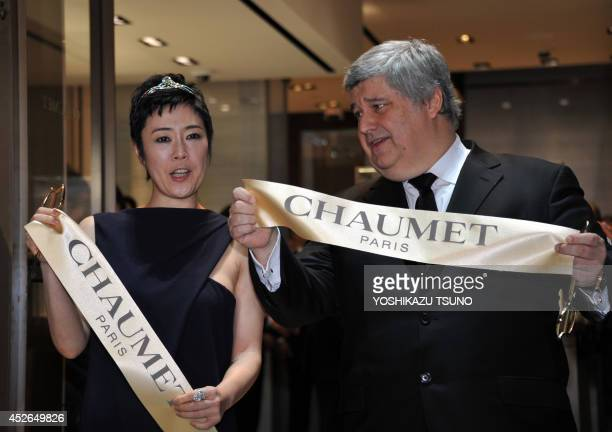 French luxury jewler Chaumet president Thierry Fritsch stands with Japanese actress Shinobu Terajima as they cut a ribbon for the reopening of...