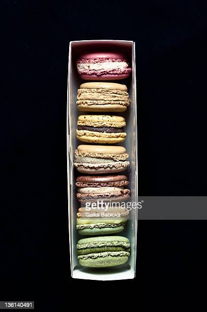 French macarons in box on black