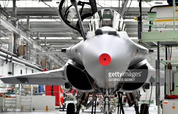 A French made Rafale jet fighter is exhibited in the workshops of DassaultAviation in Merignac near Bordeaux on October 8 2019 during the delivery...